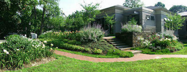 Color photograph of the 2003 Meekins Library addition and gardens from Williams St.