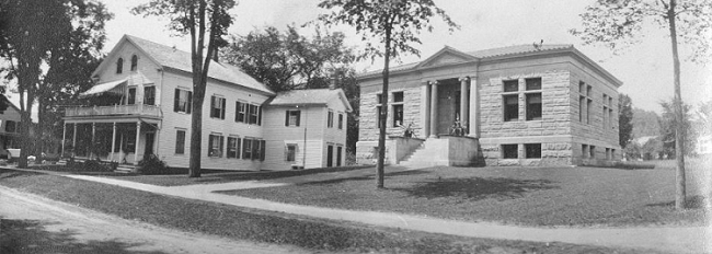 Vintage photograph of Main St. with  Porter/Mayer House next to Meekins Library