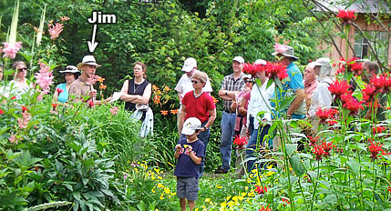 Jim McSweeney with group in his gardens.