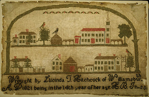 Photograph of a hand-stitched sampler picturing the Main Street of Williamsburg Mass. made in 1821 by Lucinda T. Hitchcock .